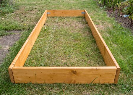 Empty raised bed on grass