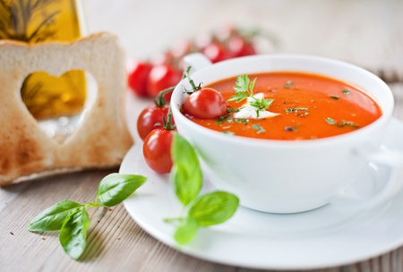 Tomato soup with heart shaped bread photo