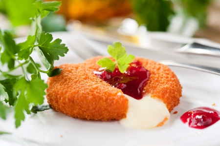 baked camembert with cranberry sauce and parsley