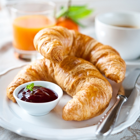 breakfast with croissants, coffee and juice