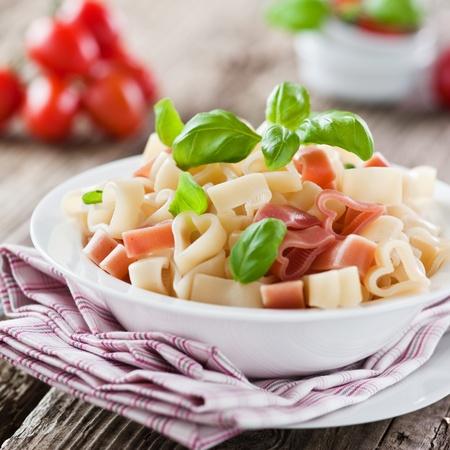 italian foods: heart shaped noodles on a plate