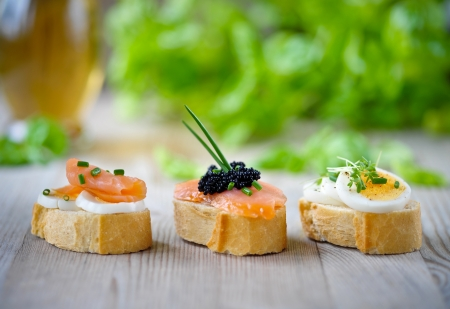 french baguette with salmon, caviar and eggs  photo