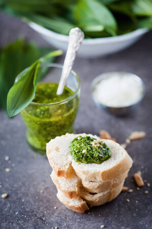 bears garlic pesto, roasted pine nuts and parmesan cheese with fresh baguette photo
