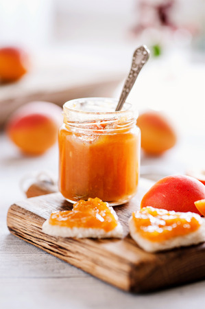 Fresh apricot jam in glass - sweet breakfast 02 Reklamní fotografie