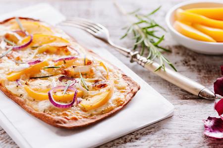 Tarte flamb?e with peaches, goat cheese, rosemary and honey