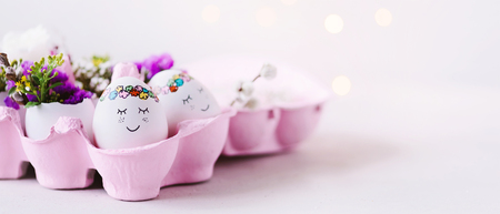 Sweet Easter greetings  Easter eggs with cute faces in pink, Easter box  banner, header