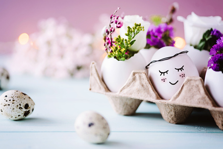 Sweet Easter card - Small easter egg with face lies in the egg carton