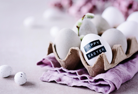 Happy Easter - Easter greetings with concrete eggs and nice lettering Фото со стока