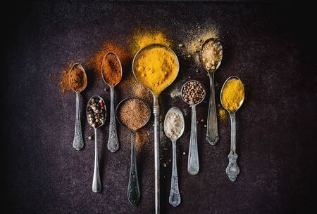 Exotic spices - different, colorful spices on different spoons and dark background 版權商用圖片