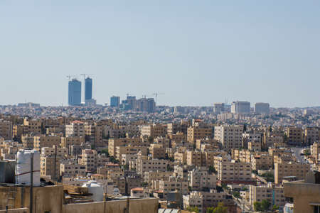 Amman city in Jordan, Amman, the capital of Jordan, is a modern city with numerous ancient ruins. Atop Jabal al-Qala'a hill, the historic Citadel includes the pillar Stock Photo - 104671300