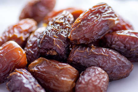dried dates on a white background Stock Photo - 104087700