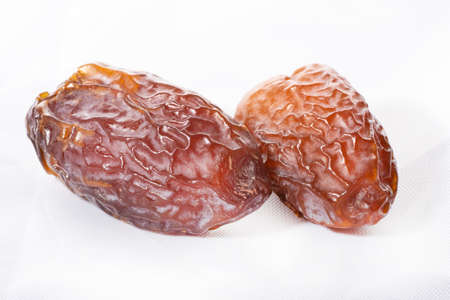 dried dates on a white background,  product of the date palm and cultivated since approximately 6000 B.C Stock Photo - 104087840