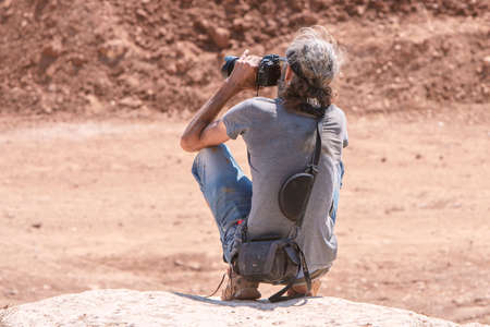 Amman, Jordan, August 10, 2018 back of photographer catch his camera at Jordan Motorsport 4x4, and he waiting for shoot at hot day in Amman Editorial
