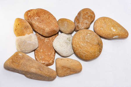 Scattered sea pebbles. Smooth stones isolated on white background