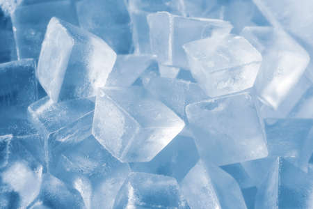Ice cubes on soft blue background. cold
