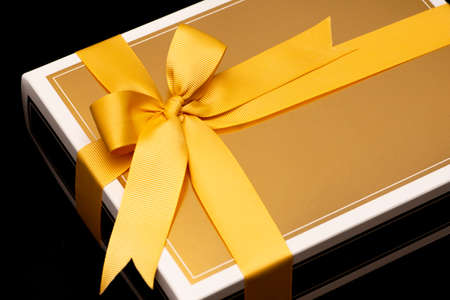 Close up to golden gift box on black background Stock Photo