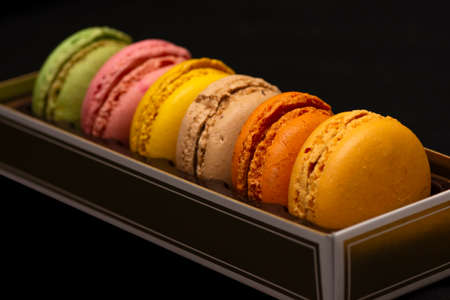 Close up to French Macaroon colors on black background Stock Photo