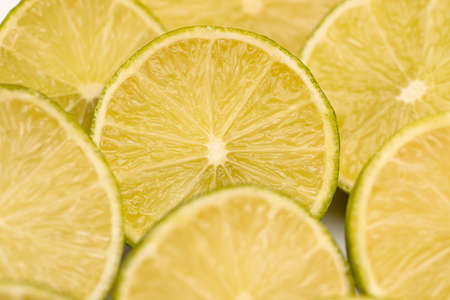 Close up to slices of lime or lemon fruits