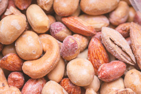 Natural background made from different kinds of nuts Stock Photo