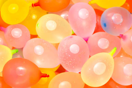 Colorful Balloons filled with water. Texture of colorful balloons filled with water