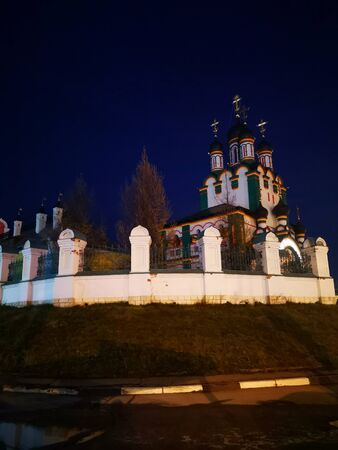 The majestic Christian church of white and green color, view at night