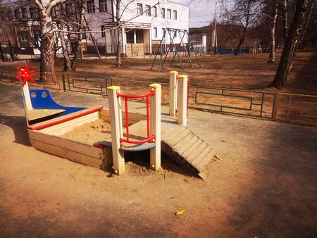 Empty colorful playground in the yard in the park, sports complex, boat sandbox