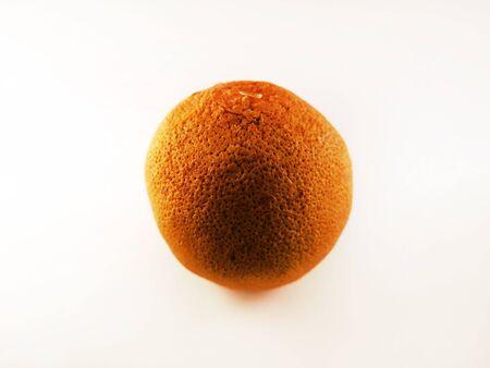 Dried whole orange on a white background, isolate. Dry orange.
