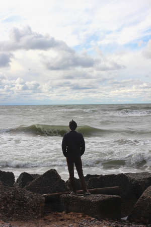 Portrait of a man staring to the horizon, in Cape Kolka, Latvia