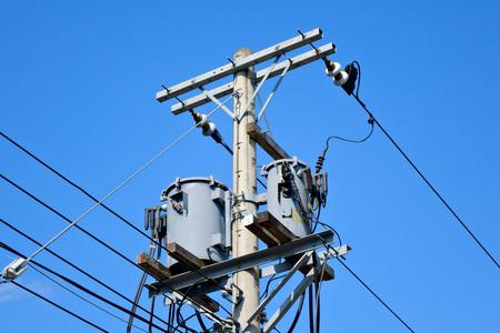 telephone pole: Telephone pole under the blue sky