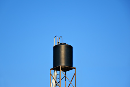 Water tower isolated on blue sky