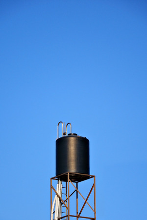 grizzle: Water tower isolated on blue sky