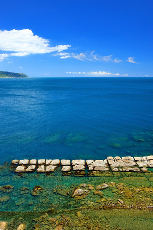 Seascape of bean curd rock in Yehliu Geopark Stock Photo