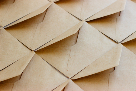 The layout of the envelope template is made of brown kraft paper.