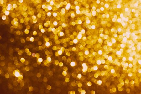 Golden shiny background. Defocused abstract background. Selective focus. Stockfoto