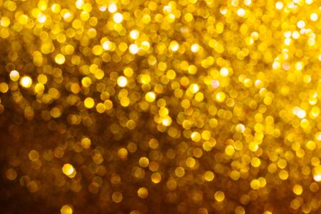 Golden shiny background. Defocused abstract background. Selective focus. Stock Photo