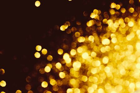 Golden shiny background. Defocused abstract background. Selective focus. 写真素材