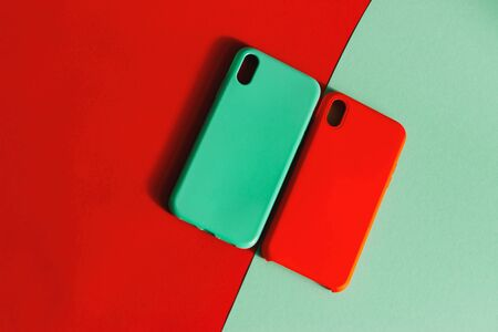 Colorful silicone cases for your smartphone. Mint and red cases for the smartphone. Protective silicone cases for smartphone. Selective focus. Stok Fotoğraf