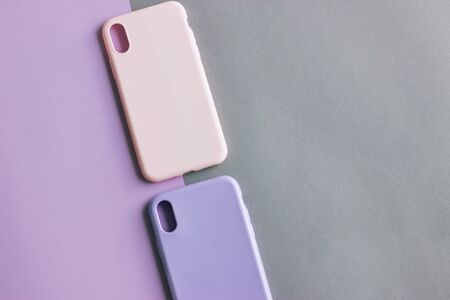 Colorful silicone cases for your smartphone on light background. Pink and purple cases for the smartphone. Protective silicone cases for phone. Selective focus.