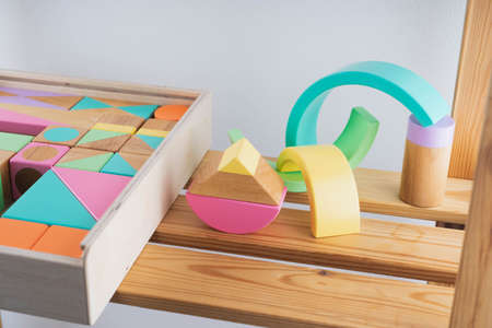 Childrens wooden toys. Wooden constructor for children. Colorful toys made of natural materials. Zero waste.