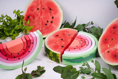 Wooden watermelon. Children's wooden toys. Toy rainbow made of natural wood for a small child. Colorful toys made of natural materials. Zero waste.