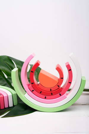 Children's wooden rainbow. Toy rainbow painted in the form of a watermelon. Zero waste toys. 版權商用圖片