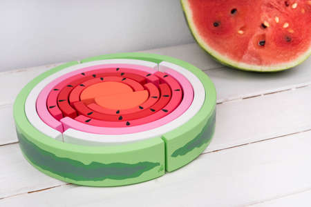 Children's wooden rainbow. Toy rainbow painted in the form of a watermelon. Wooden watermelon. Zero waste toys. 版權商用圖片