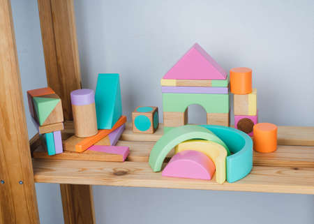 Children's wooden toys. Wooden constructor for children. Colorful toys made of natural materials. Zero waste. Developing game. 版權商用圖片