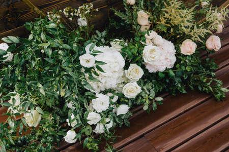 Wedding decor. Fresh flowers. Beautiful fresh greenery and flowers adorn the wedding arch. Beautiful flowers.