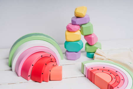 Wooden cubes with different faces for the development of coordination and balancing. Bright toys for children made of natural wood. Wooden rainbows in the form of a watermelon. Zero waste.