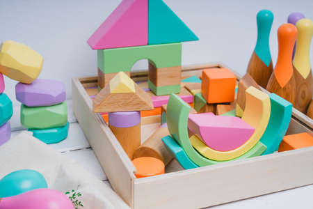 Wooden constructor for children. Colorful toys made of natural materials. Zero waste. Developing game. 版權商用圖片