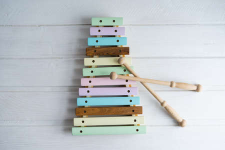 Xylophone made of natural wood. A musical instrument. Childrens toy made of natural wood. Colorful xylophone keys. 版權商用圖片