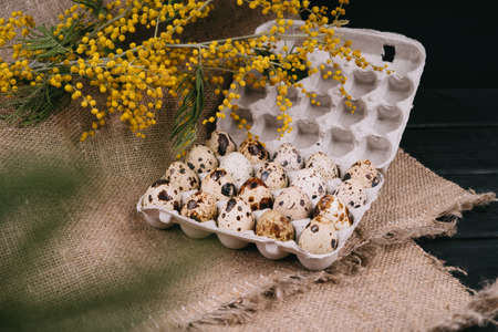 Quail eggs in eco-friendly packaging.