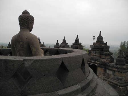 borobudur: Buddha statue in the open stupa in Borobudur, Indonesia
