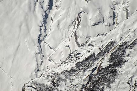 crack climbing: Snowy Mountain Wall in Himalayas